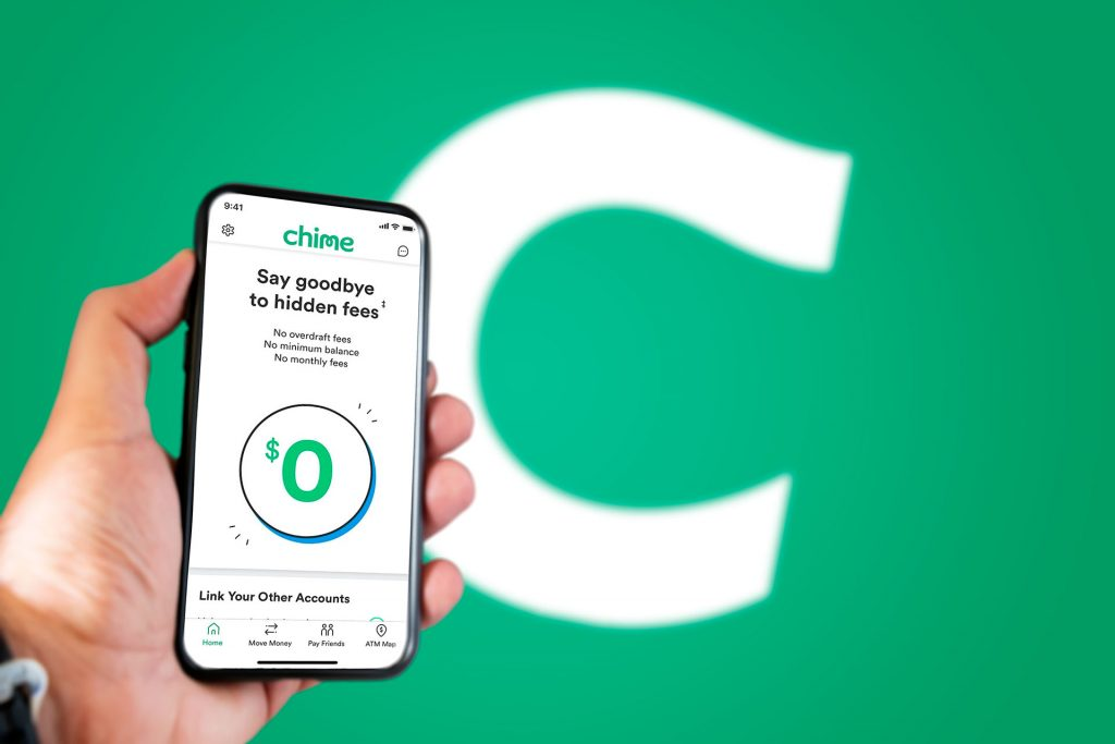A hand holding a phone with the Chime app on the screen